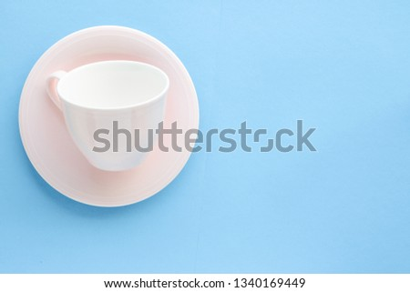 Kitchen, dishware and drinks concept - Empty cup and saucer on blue background, flatlay #1340169449