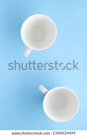 Kitchen, dishware and drinks concept - Empty cup and saucer on blue background, flatlay #1340929499