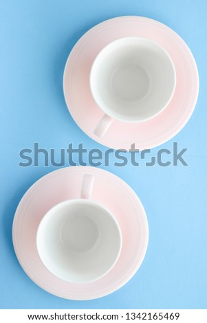 Kitchen, dishware and drinks concept - Empty cup and saucer on blue background, flatlay #1342165469
