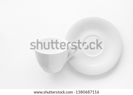 Kitchen, dishware design and drink concept - Empty cup and saucer mockup on white background, flatlay