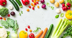 Kitchen - fresh colorful organic vegetables captured from above (top view, flat lay). Grey stone worktop as background. Layout with free text (copy) space.