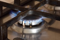 Kitchen gas stove with burning hot blue flame burner