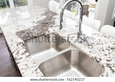 Kitchen Granite Counter Top With Large Double Sink And Chrome Faucet
