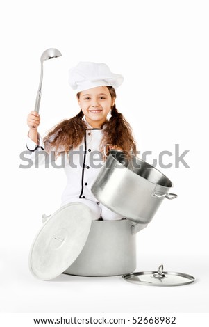 Kitchen hand. A little pretty girl dressed as a kitchen hand in a cooking pot holding a top and a ladle.