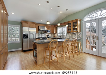 Kitchen in modern home with door to deck