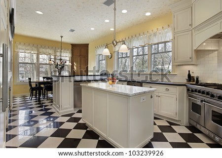 Kitchen in modern house with black and white flooring