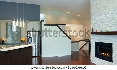 Kitchen interior design with fireplace in a new house