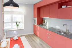 Kitchen interior in light colors. Scandinavian style. color of the year 2019 living coral pantone