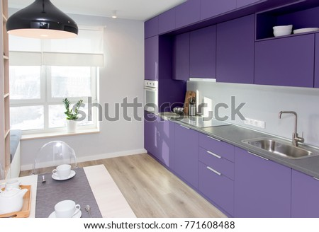 Kitchen interior in light colors. Scandinavian style in colors of the year 2018 ultra violet