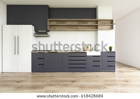 Kitchen interior with a wooden floor, black countertops and a large white bridge standing in the corner. 3d rendering.