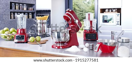 Kitchen interior with kitchen prosessor and appliances, cooking on kitchen counter