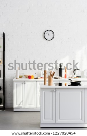 kitchen minimalistic interior with cooking supplies and devices  #1229820454