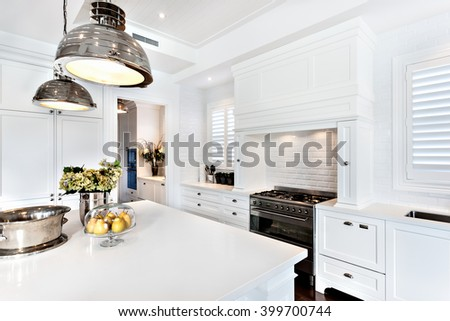 kitchen of luxury and beautiful house with fruit, flower and vessel kept on dinning table