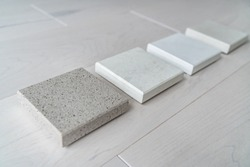 Kitchen remodel home renovation interior design consultation for countertop choices - quartz sample at store.