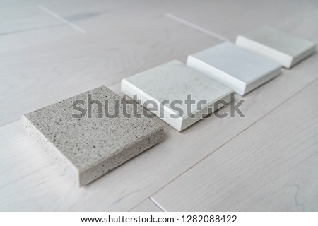 Kitchen remodel home renovation interior design consultation for countertop choices - quartz sample at store.