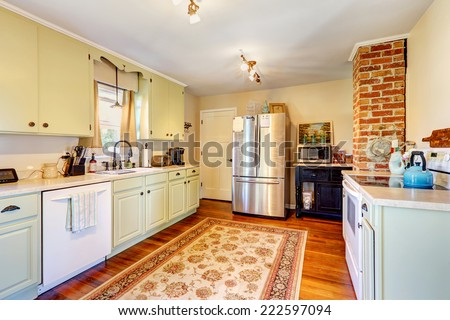 Kitchen room interior in old house with brick and light mint storage combination