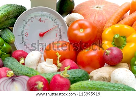 kitchen scales and fresh vegetables close up