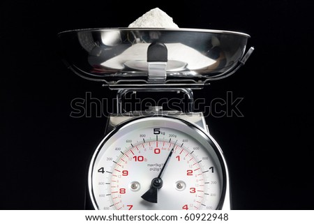 kitchen scales with flour
