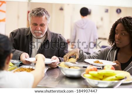Kitchen Serving Food In Homeless Shelter