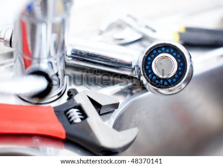 Kitchen sink.  Adjustable wrench. Plumbing. Plumber tool