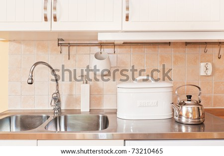 kitchen sink with utensil