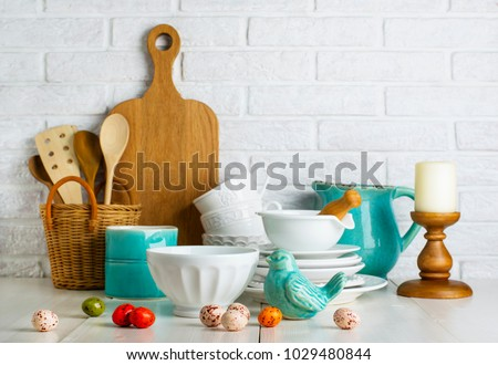 Kitchen still life with ceramic bird and easter eggs and utensils #1029480844