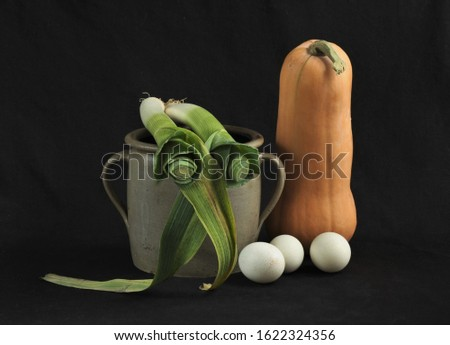 Kitchen still life with eggs and vegetables