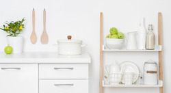 Kitchen storage drawers and shelves with ceramic and wooden dishware
