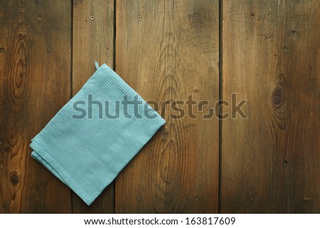 Kitchen Table/Cookbook Background. An Old Wooden Kitchen Table With Kitchen Dish Cloth.