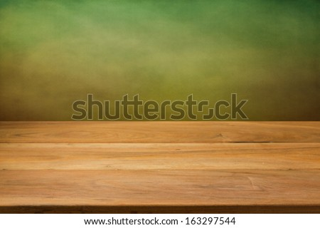 Kitchen table over green grunge background
