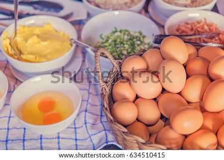 kitchen table with eggs on...