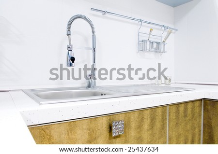 Kitchen tap, indoors shot