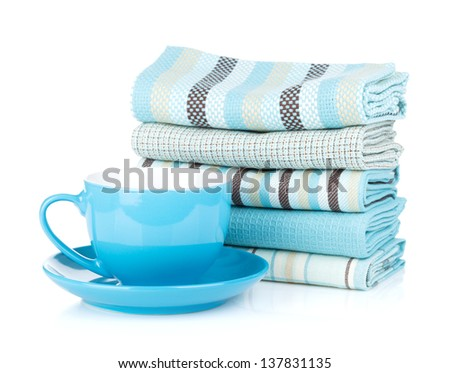 Kitchen towels and blue coffee cup. Isolated on white background