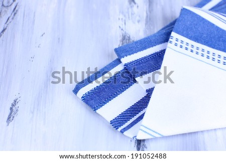 Kitchen towels on wooden background