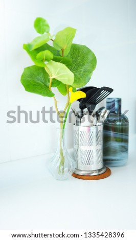 Kitchen utensils and decorative trees and decorative bottle #1335428396