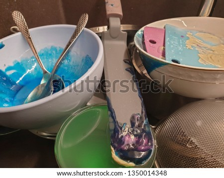 kitchen utensils and kitchen accessories ready for washing after preparing a cake #1350014348