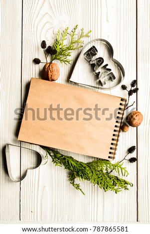 kitchen utensils and notepad for culinary recipes  frame for text