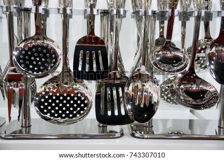 Kitchen utensils hang on the shelf #743307010