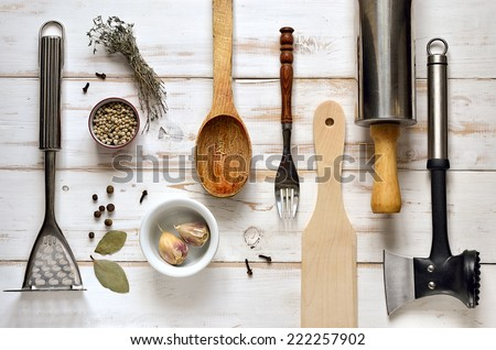 Kitchen utensils on a light rustic wooden background Stock photo ©