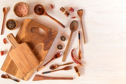 Kitchen utensils on a wooden background. Various kitchen utensils on wooden table. Chef tools. Home cooking.