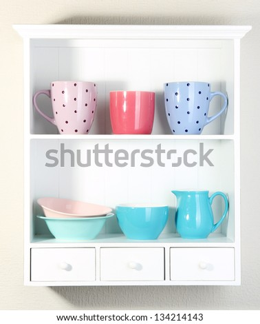 Kitchen utensils on beautiful white shelves