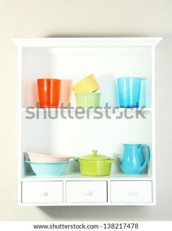 Kitchen utensils on beautiful white shelves