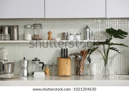 Kitchen utensils on kitchen counter. #1021204630