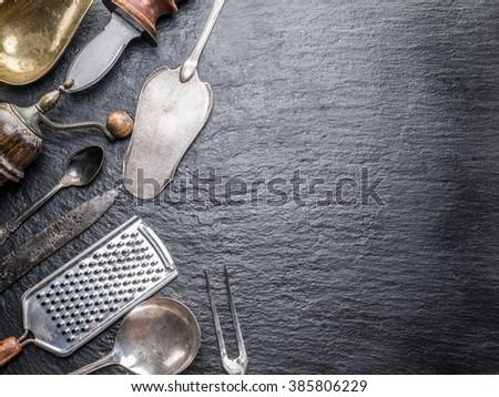 Kitchen utensils on the graphite background. #385806229