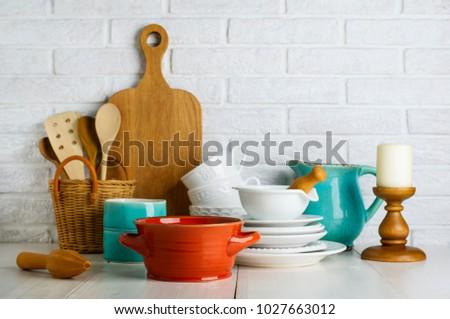 Kitchen utensils on the white table  #1027663012