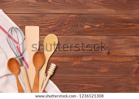 Kitchen utensils top view on wooden table. The devices helping for cooking. place to insert text #1236521308