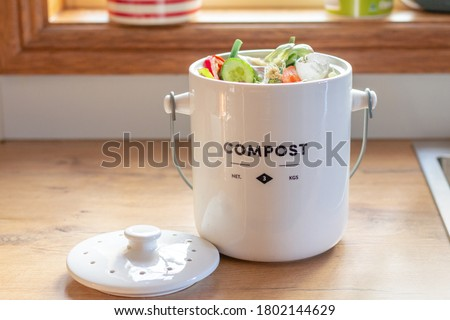 kitchen waste compost pot containing kitchen waste on kitchen counter top, sustainable living organic waste recycling,