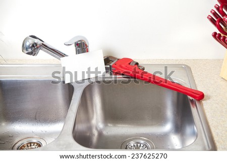 Kitchen Water tap and sink. Renovation  and plumbing.