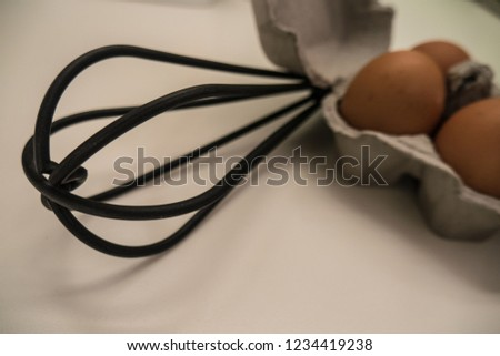 kitchen whisk and eggs  #1234419238