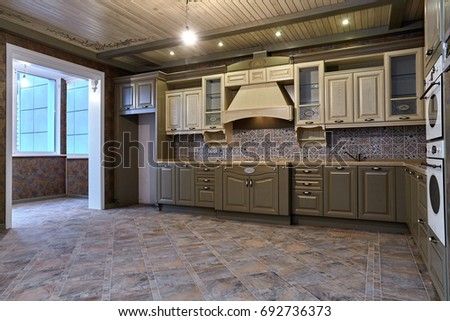 kitchen with appliances and a beautiful interior - Shutterstock ID 692736373